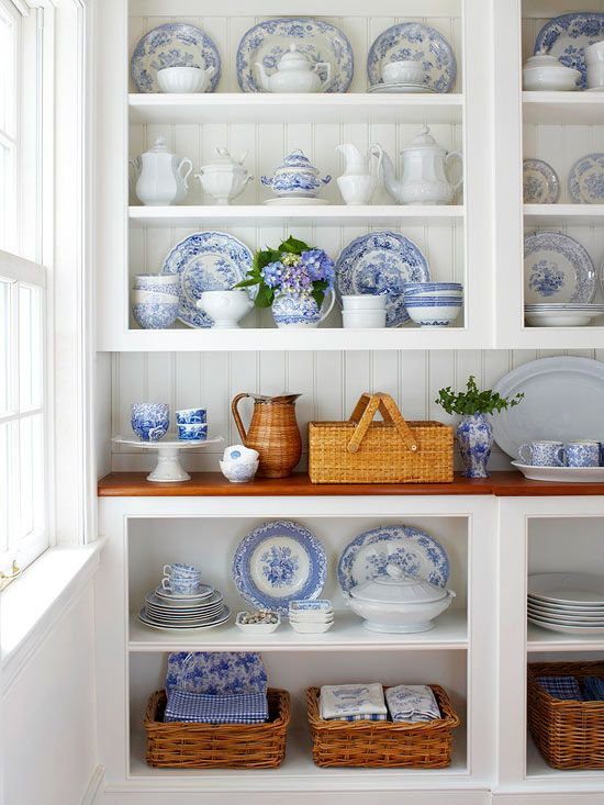 By opening up your kitchen cabinets and turning them into open shelving, you can create a lovely display of antique china right in your kitchen!