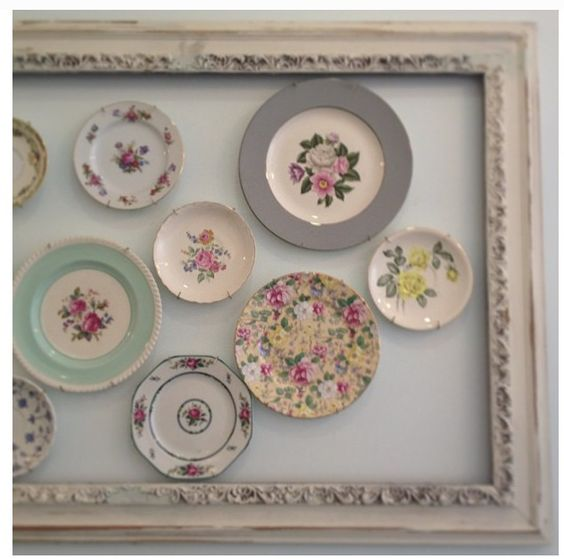 If you want to create an artistic display with your antique china, simply put a frame around it!
