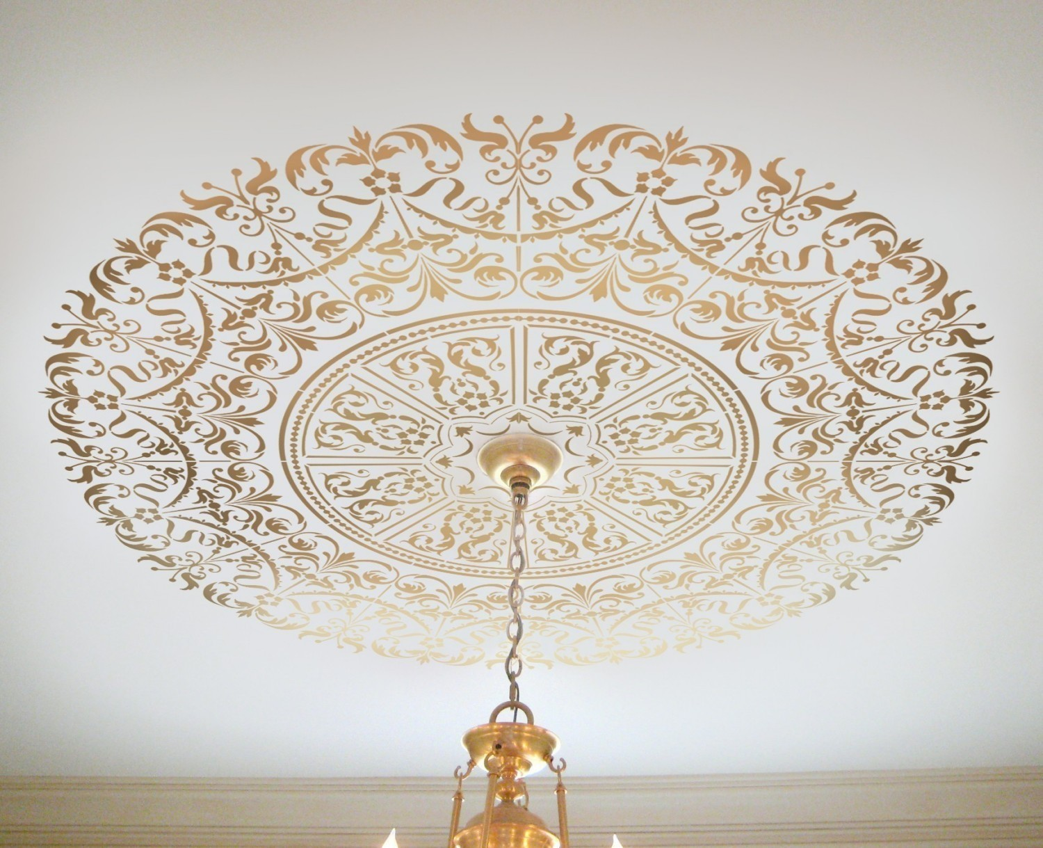 While medallions have always been a popular ceiling accent, you can easily paint your own using a stencil or use a vinyl decal to create an elegant and inspiring ceiling.