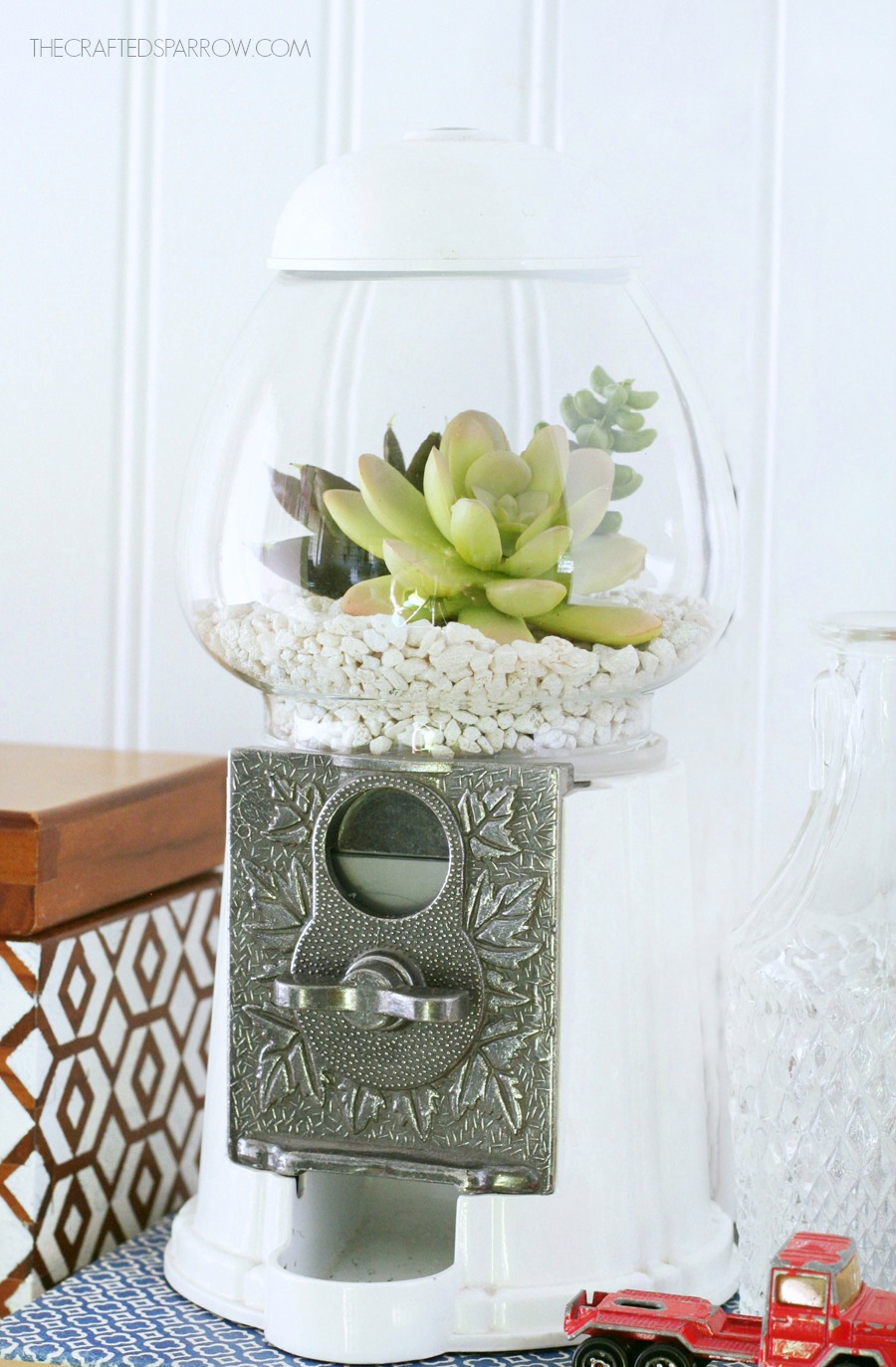 use a vintage gumball machine for a succulent planter