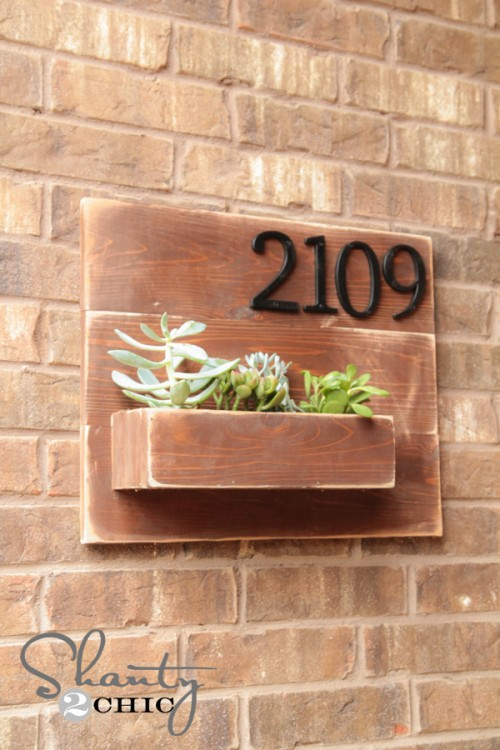 use succulents in your address number sign to make your home stand out