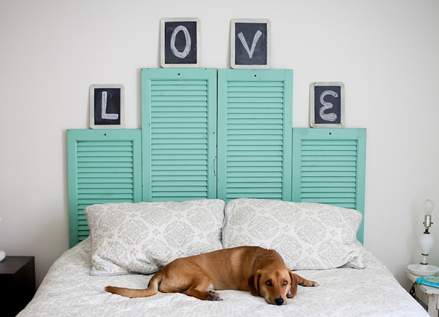 Instead of buying an expensive headboard, simply make your own by upcycling old shutters!