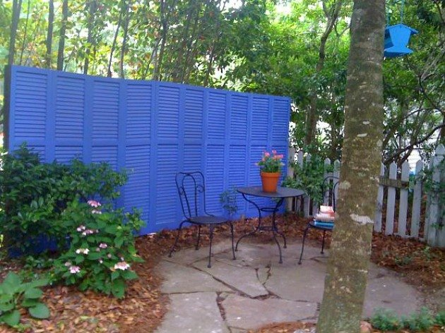 Add a little privacy to your backyard by making a privacy screen out of shutters.