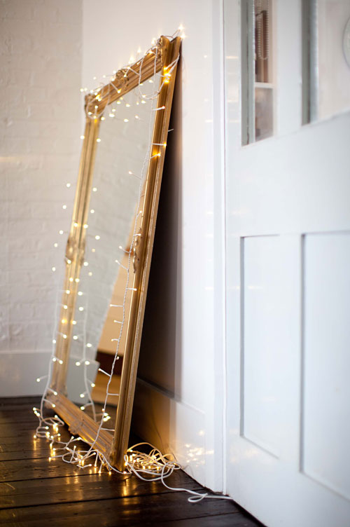 update your vintage mirror with dreamy string lights