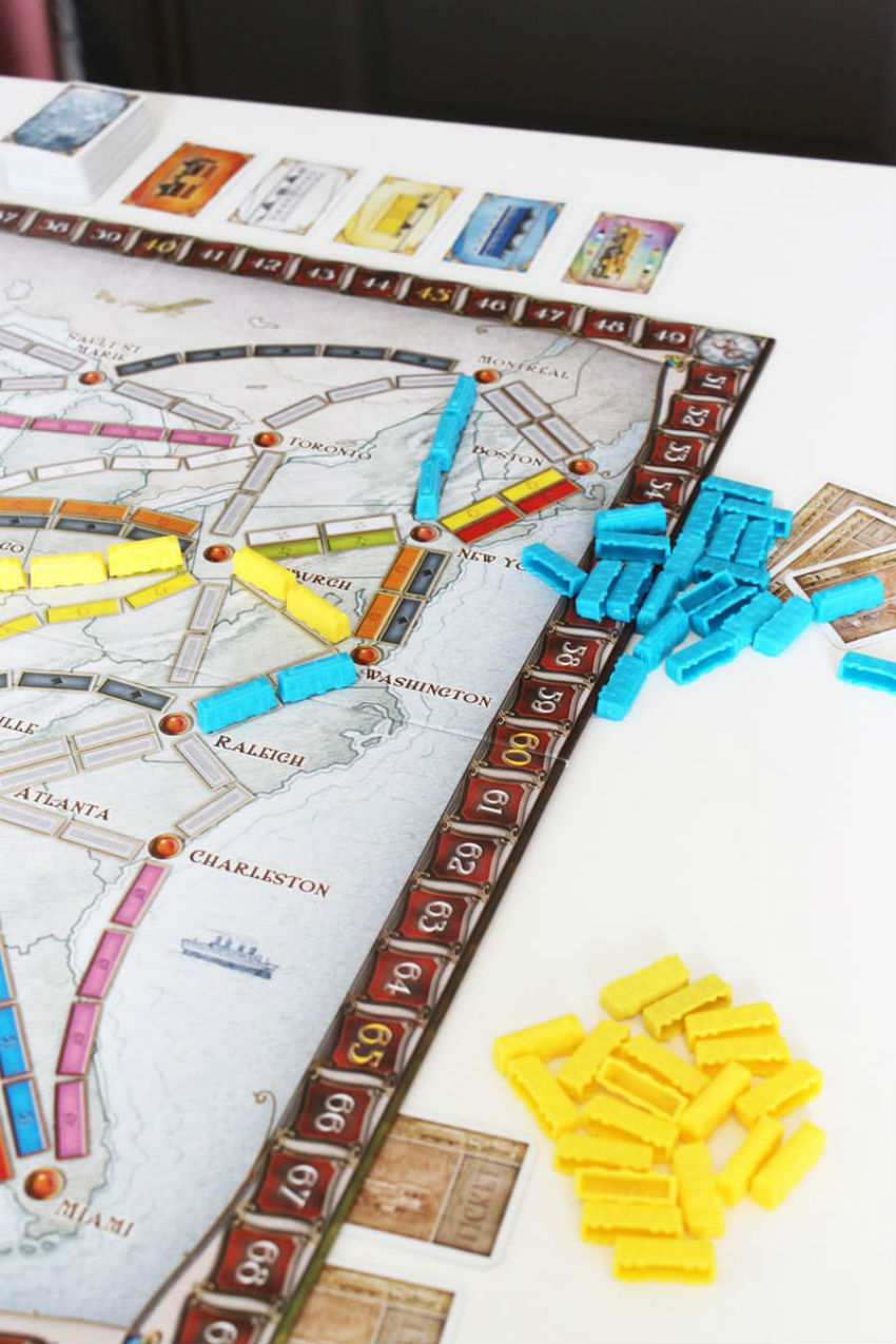 Board games and a no brainer. Just pick the right one for the ages and interests. Image Source: Apartment Therapy