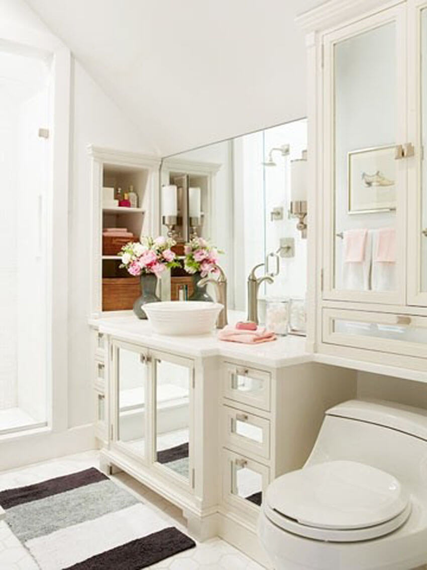 Add mirrors in unexpected places to make your apartment bathroom seem bigger.