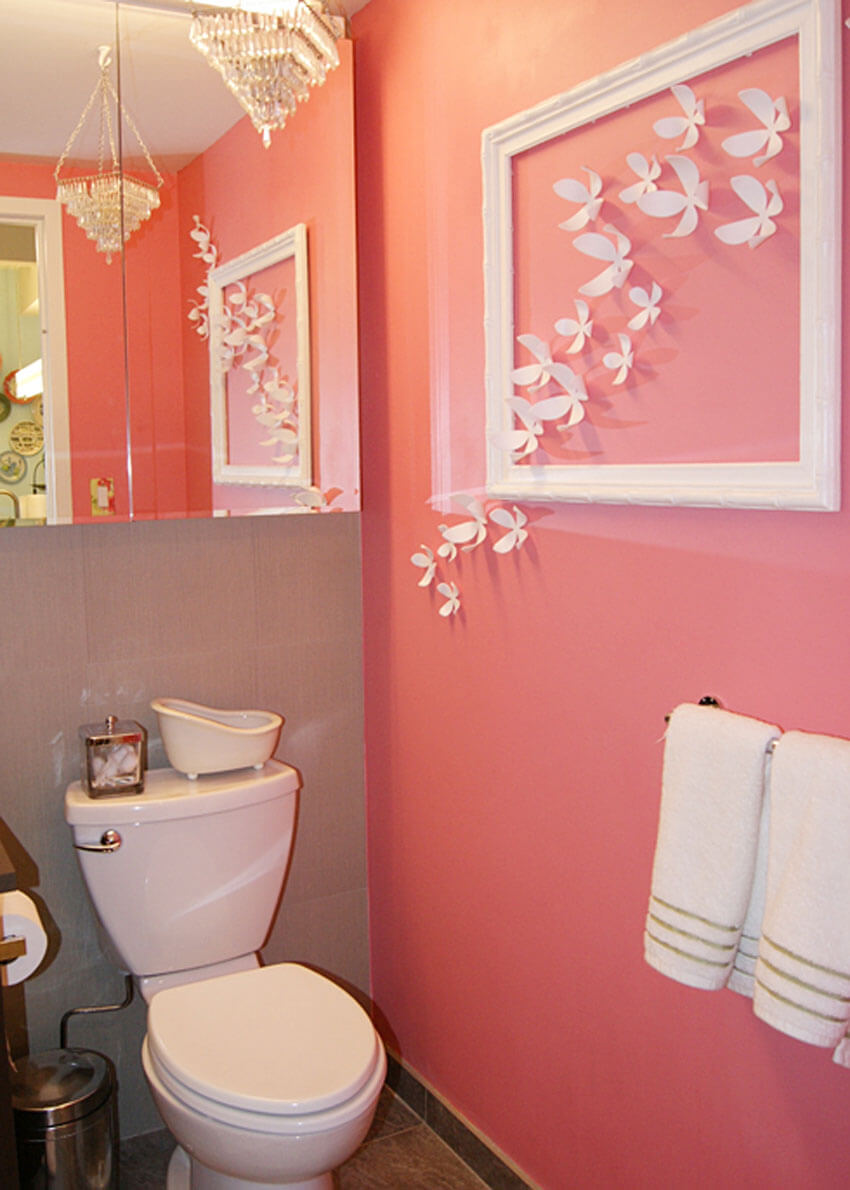 Add colorful wall decor to your apartment bathroom.