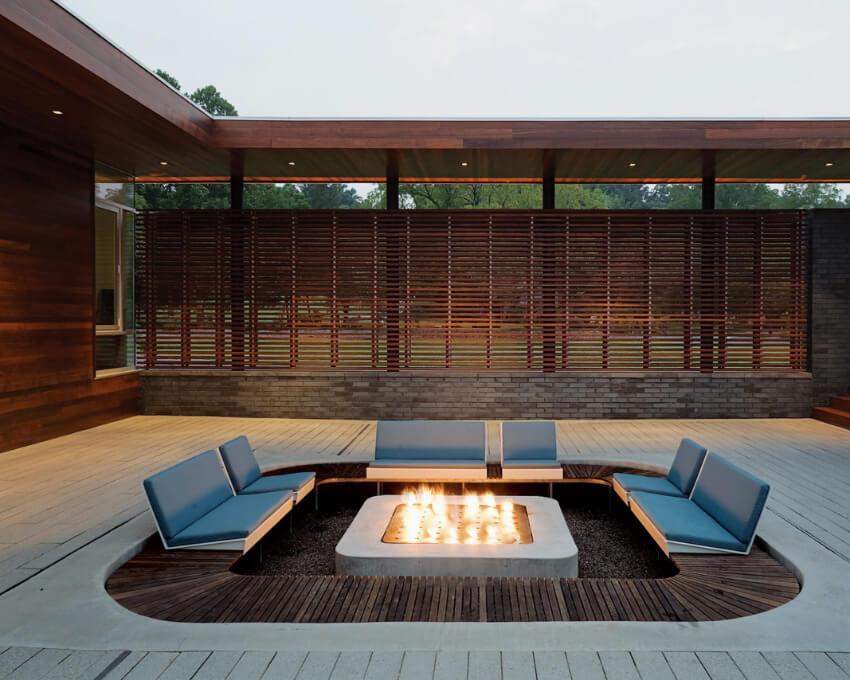 A sunken fire fire is perfect for a minimalist backyard. Source: Decoor