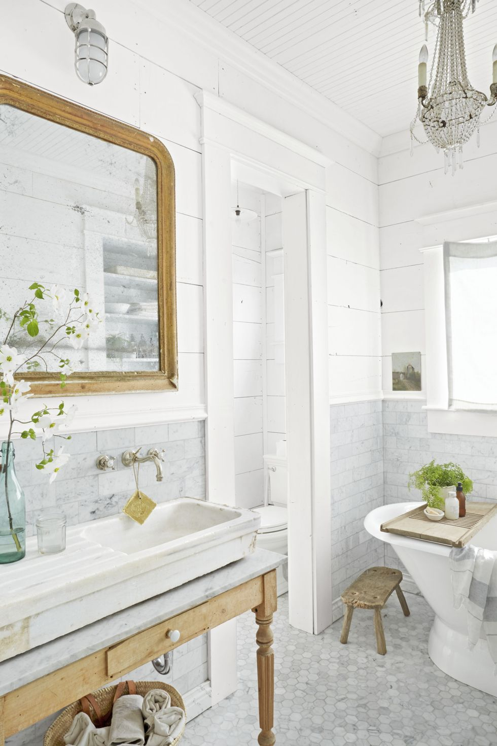 White marble looks gorgeous on the bathroom. Source: Country Living