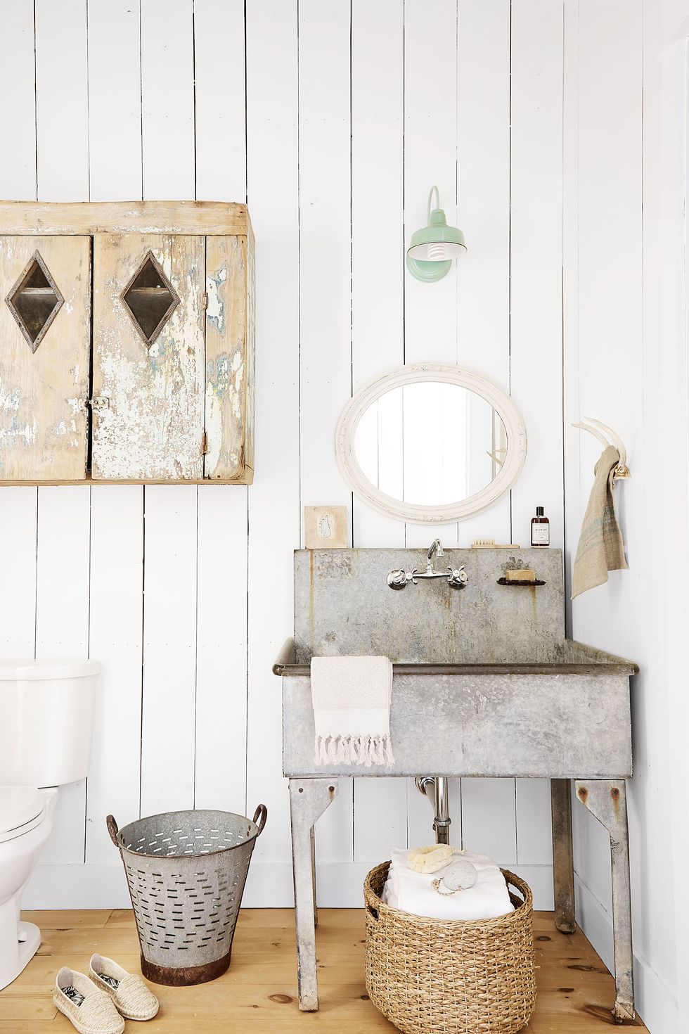 This french zink sink steals the show in this bathroom. Source: Country Living